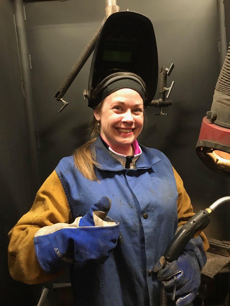 Woman in welding gear
