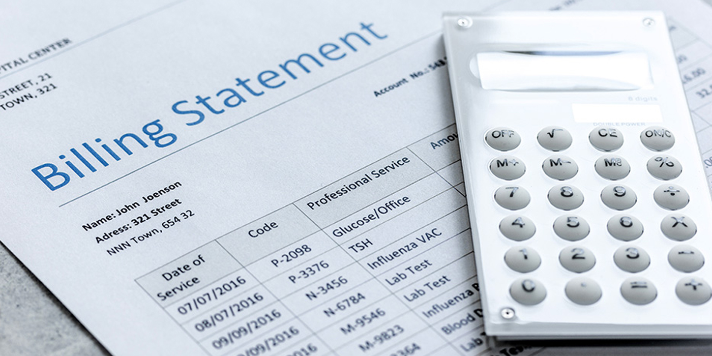 Calculator on top of medical billing statement
